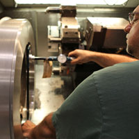 industrial employee working with a cnc mill