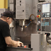 Industrial skilled labor working on machine